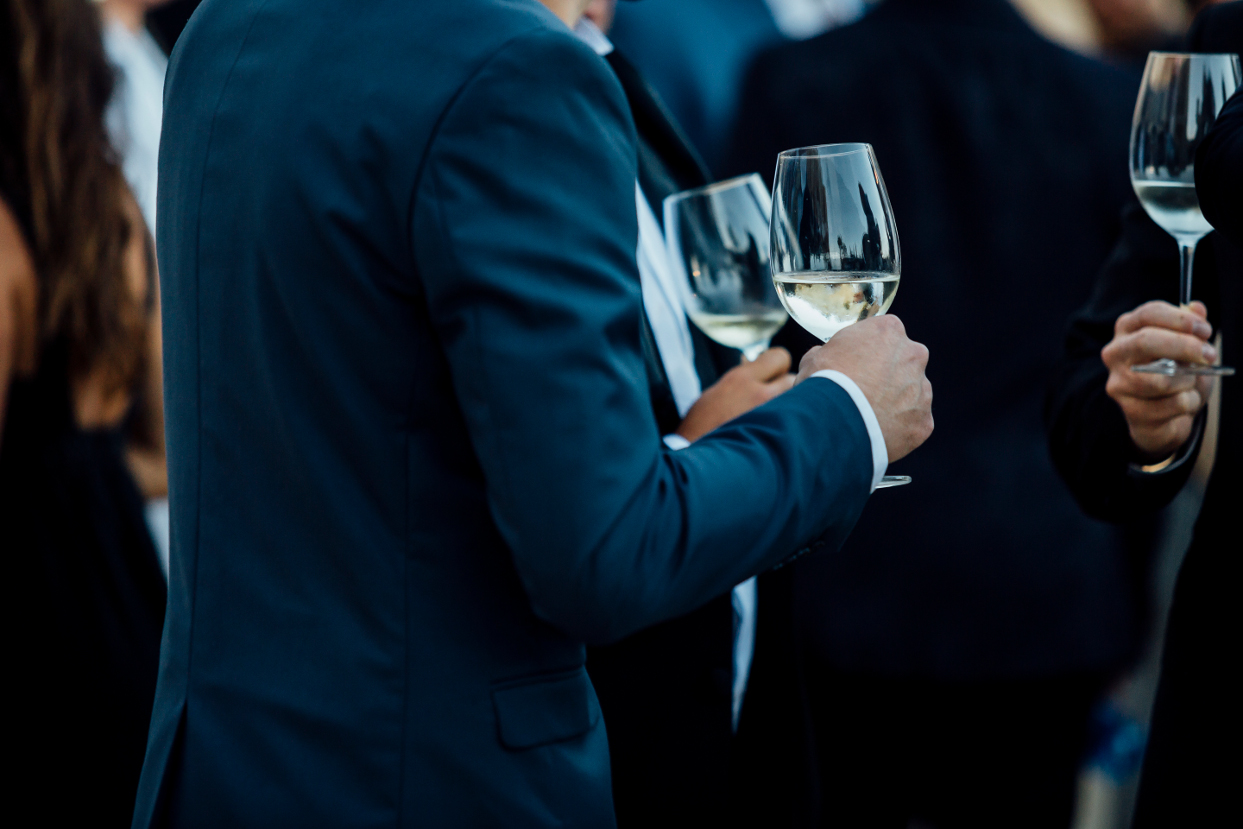 Men drinking wine at corporate event