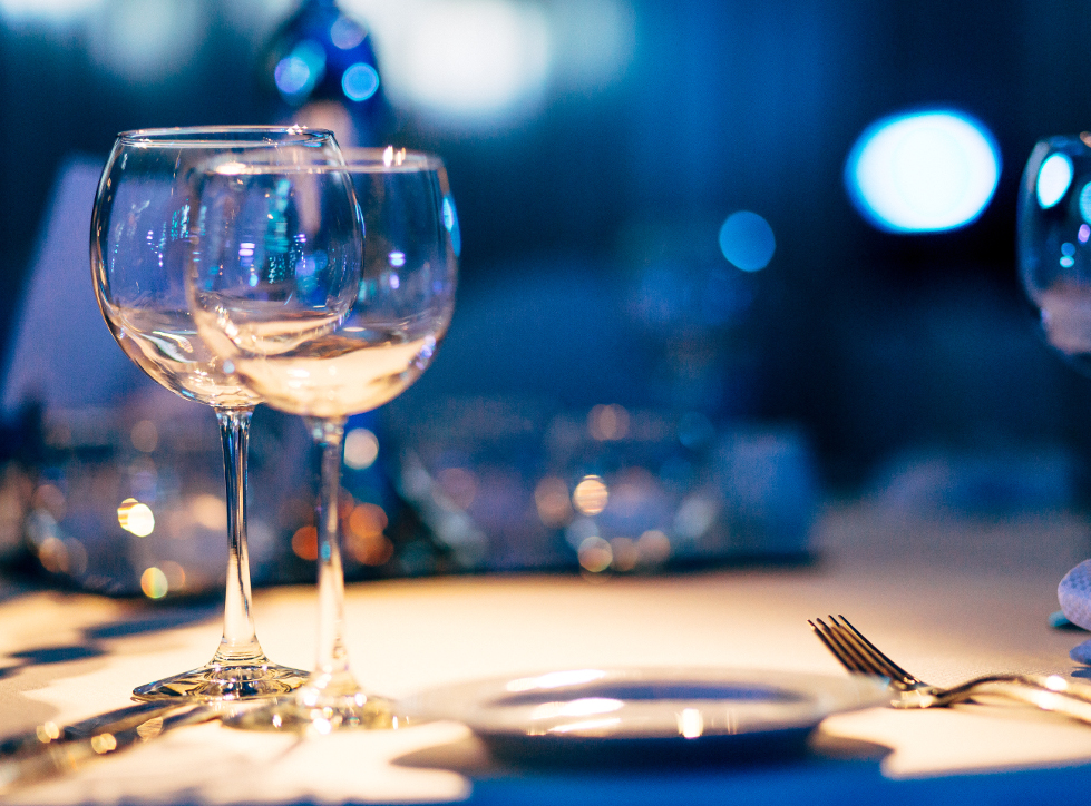 table with glassware at corporate event